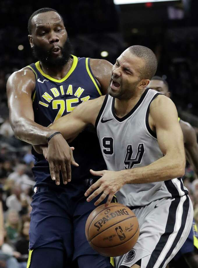 San Antonio Spurs guard Tony Parker (9) is blocked and fouled by Indiana Pacers center Al Jefferson (25) as he drives to the basket during the second half of an NBA basketball game, Sunday, Jan. 21, 2018, in San Antonio. (AP Photo/Eric Gay) Photo: Eric Gay, STF / Associated Press / Copyright 2018 The Associated Press. All rights reserved.