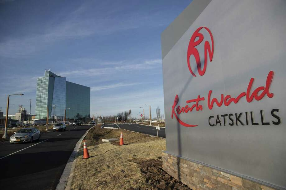 Traffic moves past a sign for the Resorts World Catskills casino, hotel and entertainment complex, operated by Empire Resorts Inc. in Monticello, New York, U.S., on Friday, Jan. 26, 2018. Empire Resorts, controlled by Lim Kok Thay, chairman of Genting Bhd., on Feb. 8 will open Resorts World Catskills, a $1.2 billion casino, hotel and entertainment complex at the site of the old Concord Resort Hotel, the largest of the upstate New York resorts that helped launch the careers of Rodney Dangerfield, Jerry Lewis, Sid Caesar, Joan Rivers and other Jewish comedians. Photographer: Victor J. Blue/Bloomberg Photo: Victor J. Blue, Bloomberg News Service / © 2018 Bloomberg Finance LP