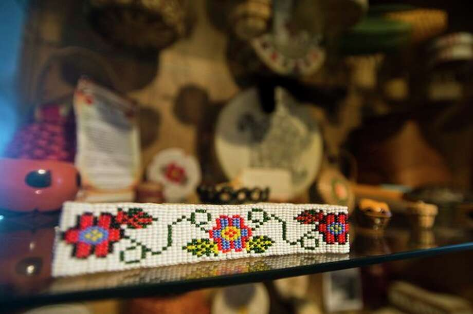 Native American artifacts fill a display case inside the home of Midland resident Quita Shier. (Katy Kildee/kkildee@mdn.net)