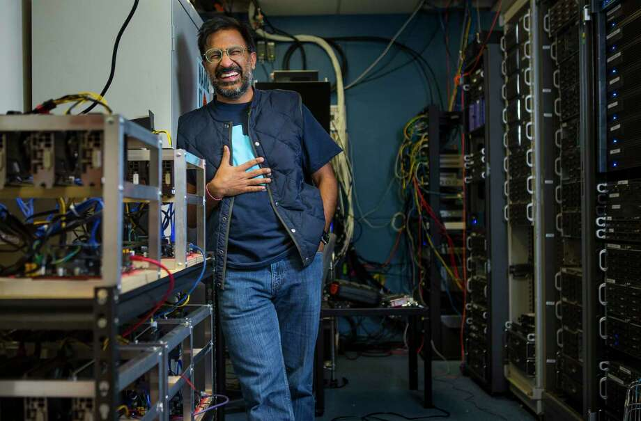 SnapStream CEO Rakesh Agrawal, next to one of the cryptocurrency mining rigs that his company is building. Photo: Mark Mulligan, Houston Chronicle / © 2018 Houston Chronicle