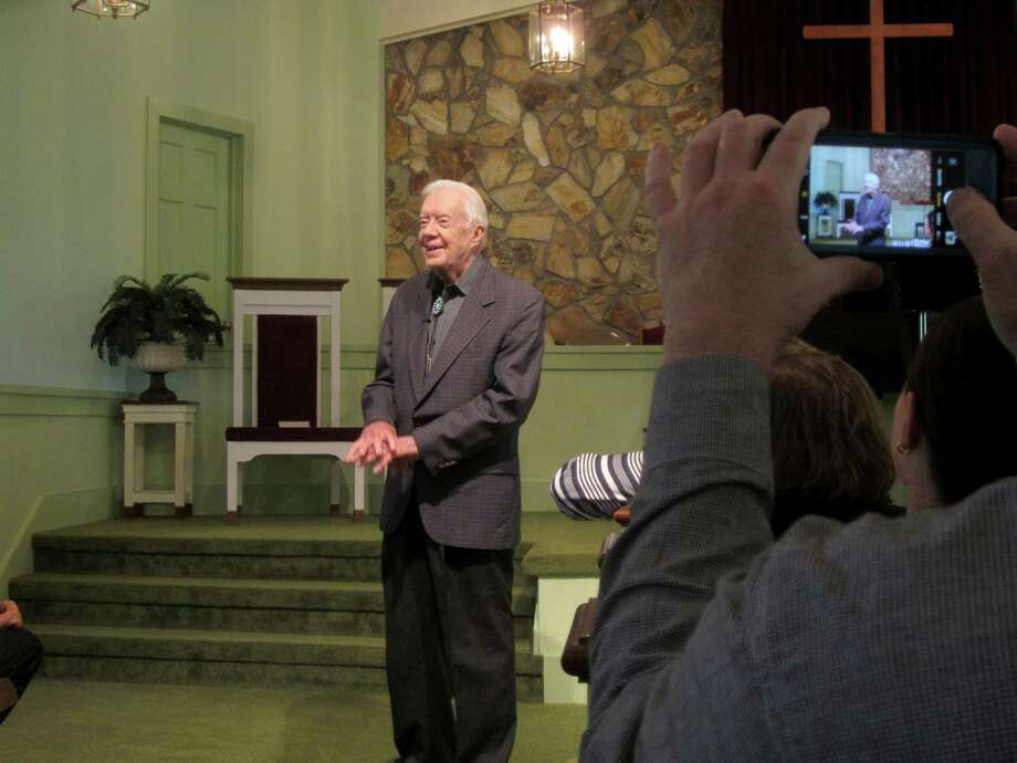 President Jimmy Carter greets the congregation ahead of his Sunday school lesson at Maranatha Baptist Church in Plains, Georgia. Photo: Photo For The Washington Post By Becca Milfeld / Becca Milfeld