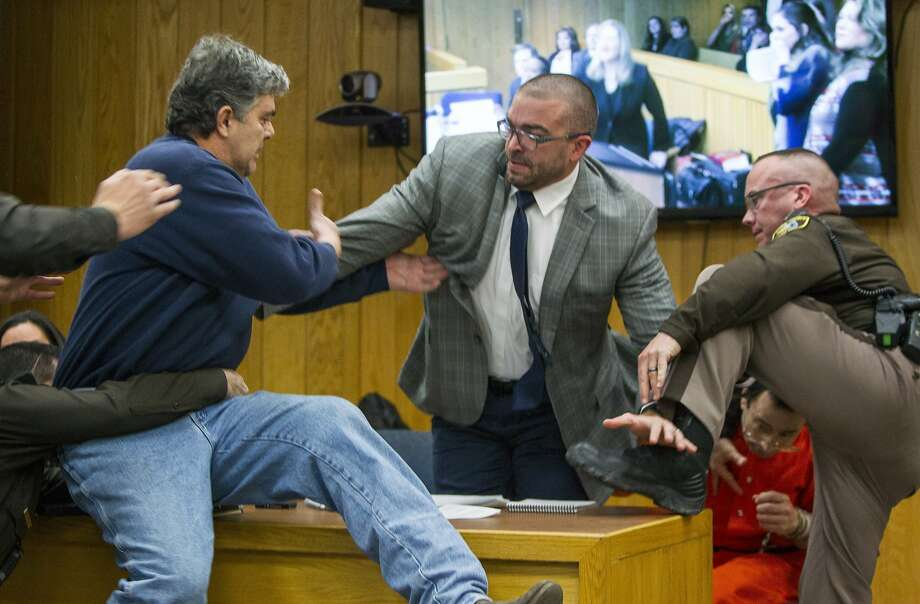 Victims' dad apologies after lunging at Nassar in courtroom