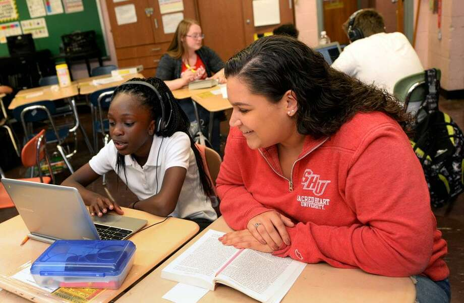 Sacred Heart University student Ashley Soules, right, works with a John Winthrop Elementary  School student as part of the University's Jones-Zimmermann Academic Mentoring Program (AMP).  Recently, the AMP program received a $45,000 grant from the Marie and John Zimmermann Fund, Inc., to support its work. Photo: Photo By Tracy Deer-Mirek / © Sacred Heart University