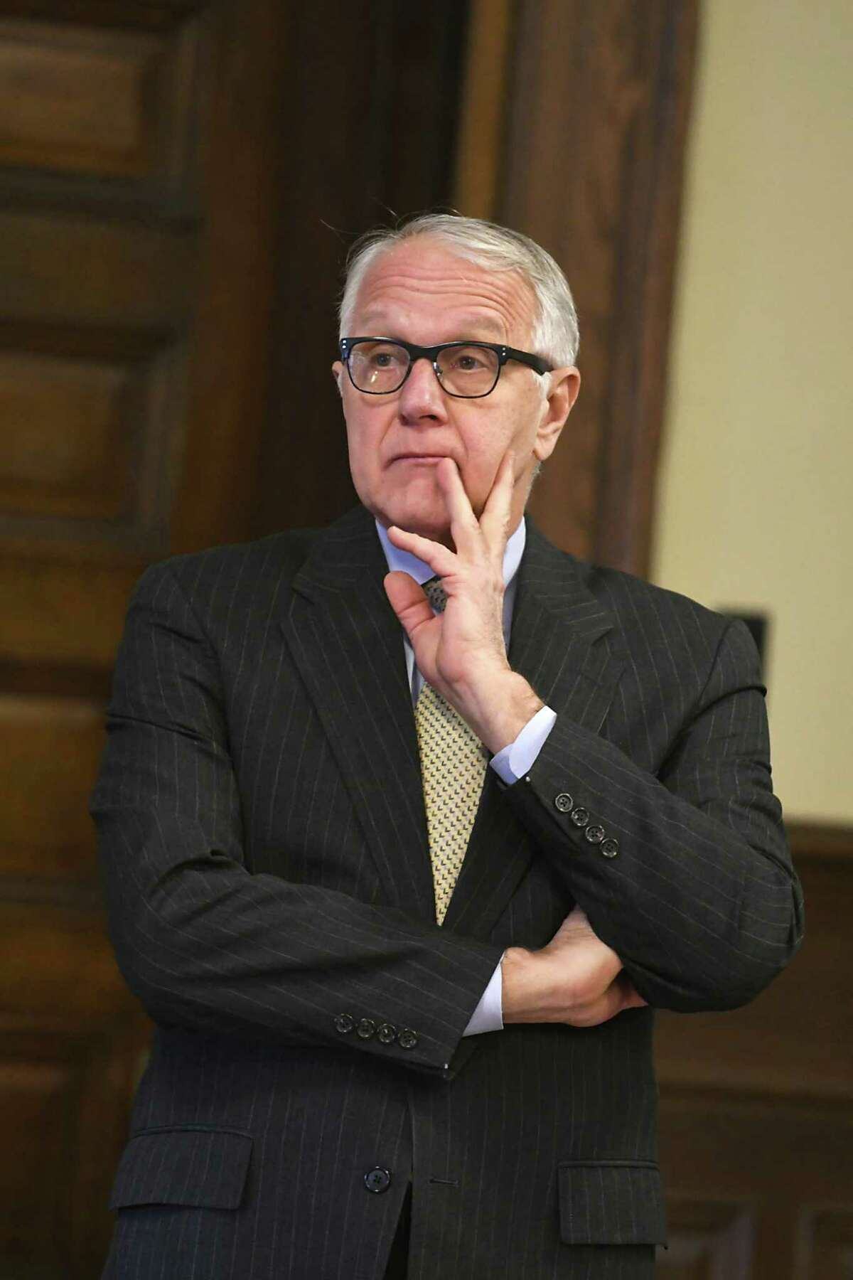 Special prosecutor Paul Czajka watches Albany County Court Judge Peter Lynch open a sealed indictment at the Rensselaer County Court House on Friday, Feb. 2, 2018 in Troy, N.Y. (Lori Van Buren/Times Union)