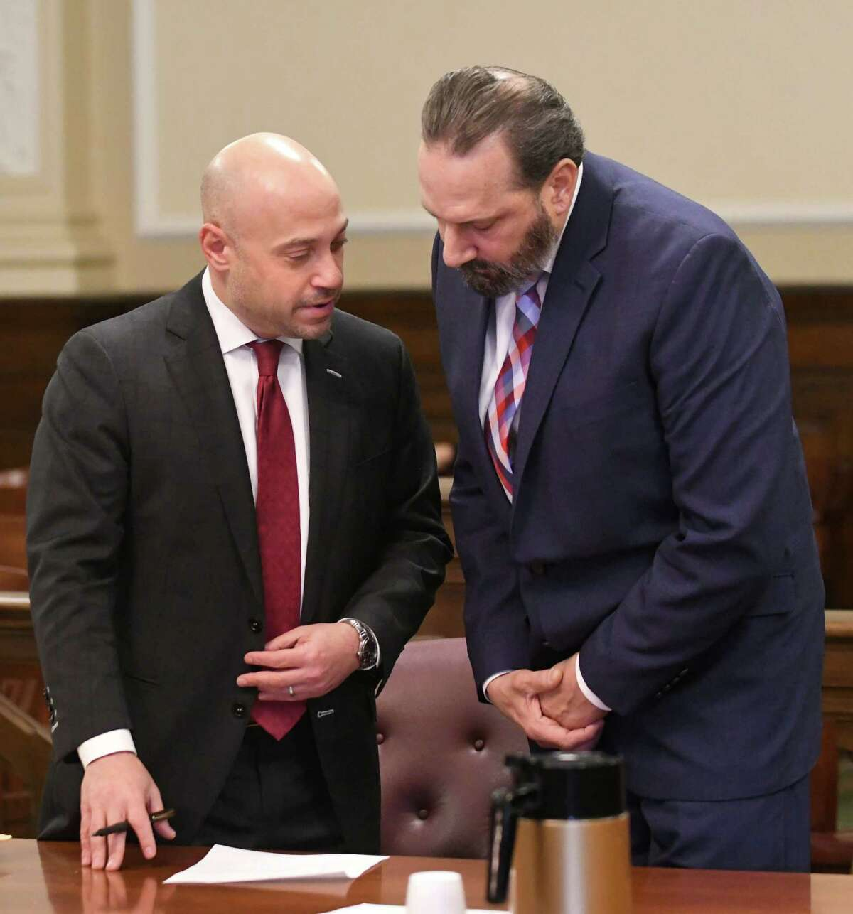 Defense attorney Andrew Safranko left, stands with his client detective John Comitale Jr. as Albany County Court Judge Peter Lynch opens a sealed indictment at the Rensselaer County Court House on Friday, Feb. 2, 2018 in Latham, N.Y. Safranko and another man were indicted in a coverup in a warrantless search. (Lori Van Buren/Times Union)