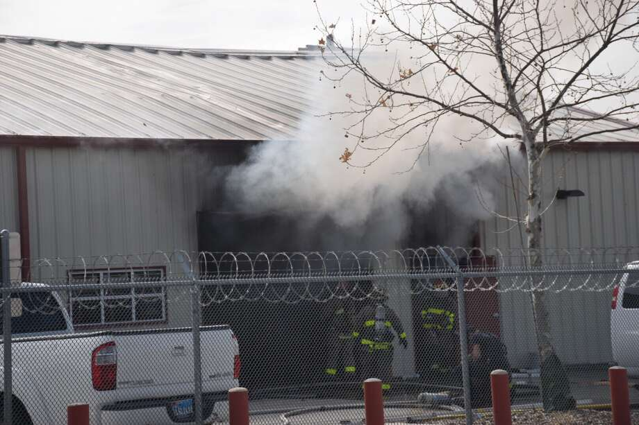 Firefighters on Friday responded to a blaze at an East Side office building. Photo: Caleb Downs / San Antonio Express-News