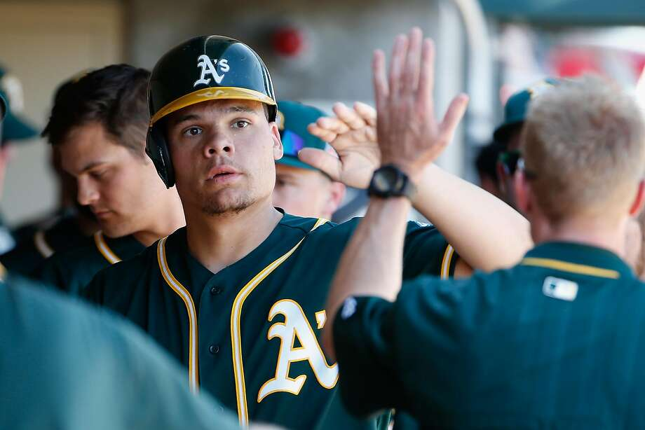 SCOTTSDALE, AZ - MARCH 04:  Bruce Maxwell #63 of the Oakland Athletics high fives teammates in the dugout after scoring a second inning run against the Arizona Diamondbacks during the spring training game at Salt River Fields at Talking Stick on March 4, 2016 in Scottsdale, Arizona.  (Photo by Christian Petersen/Getty Images) Photo: Christian Petersen, Getty Images