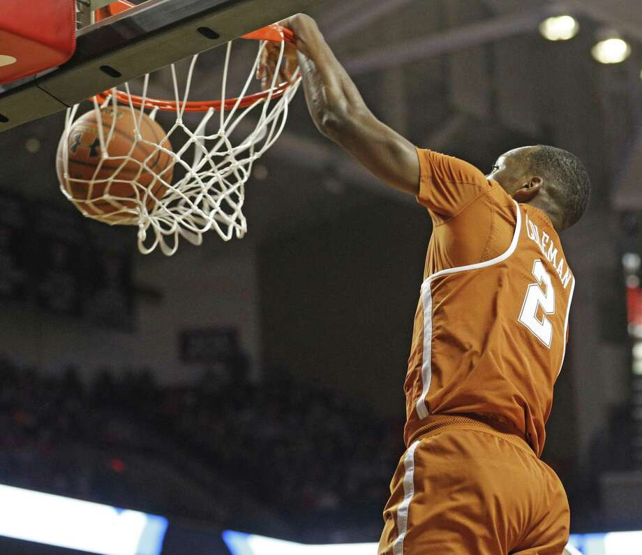 Texas' Matt Coleman (2) dunks during the second half of the team's NCAA college basketball game against Texas Tech, Wednesday, Jan. 31, 2018, in Lubbock, Texas. (AP Photo/Brad Tollefson) Photo: Brad Tollefson, FRE / Associated Press / FR171432 AP