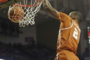 Texas' Matt Coleman (2) dunks during the second half of the team's NCAA college basketball game against Texas Tech, Wednesday, Jan. 31, 2018, in Lubbock, Texas. (AP Photo/Brad Tollefson)
