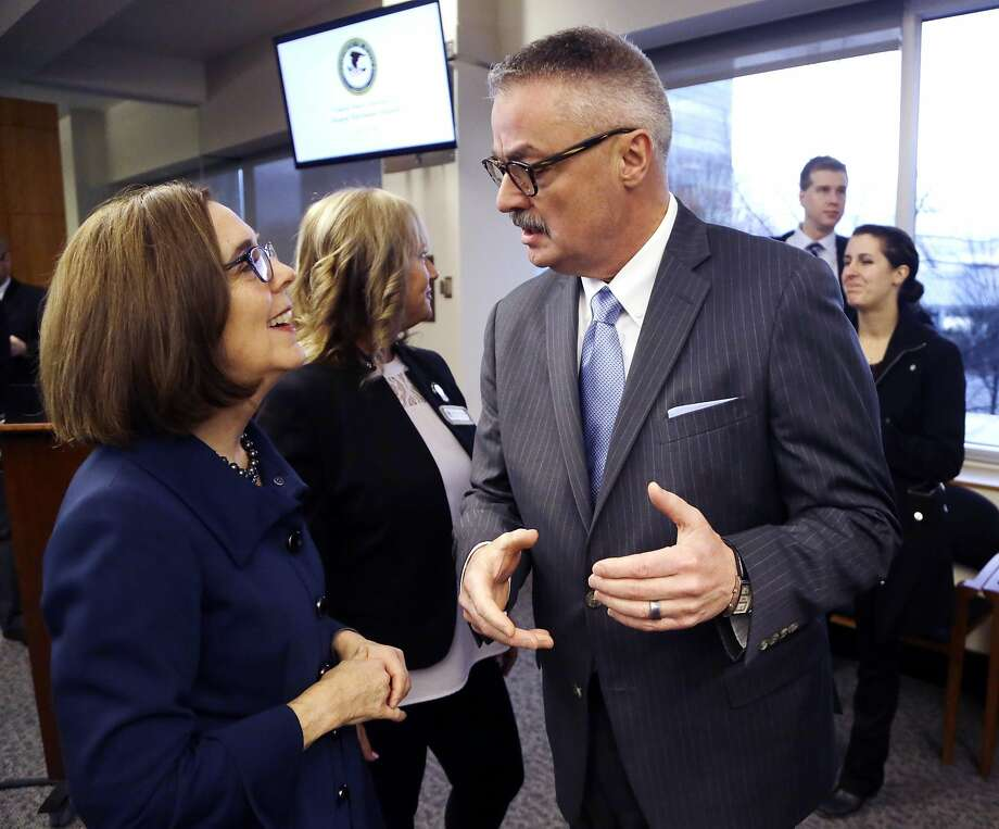 U.S. Attorney for the District of Oregon Billy J. Williams, right, talks with Oregon Gov. Kate Brown before the start of a marijuana summit in Portland, Ore., Friday, Feb. 2, 2018. Oregon's top federal prosecutor is holding the marijuana summit to hear how the state, law enforcement, tribal and industry leaders plan to address a pot surplus that he says has wound up on the black market in other states and is fueling crime. (AP Photo/Don Ryan) Photo: Don Ryan, Associated Press