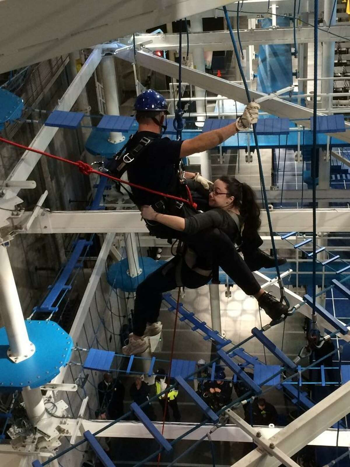 About 15 New Haven firefighters performed a series of training evolutions at Jordan?'s Furniture It Adventure Indoor Ropes Course Friday morning.