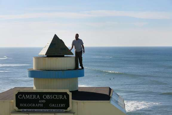 Robert Tacchetto, owner Camera Obscura, opens the door to the lens of  the Giant Camera to clean it before opening for business that day on Monday, January 30, 2018 in San Francisco, Calif.