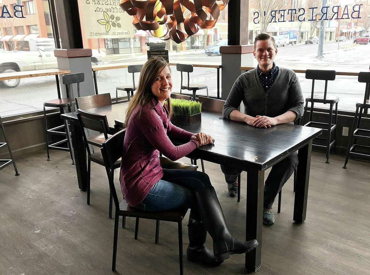 Barrister's Coffee House owner Tracy Hoekenga and manager Jordan Jones sit at one of the tables in the new coffee shop in Danbury, Conn., on Friday, Feb. 2, 2018.