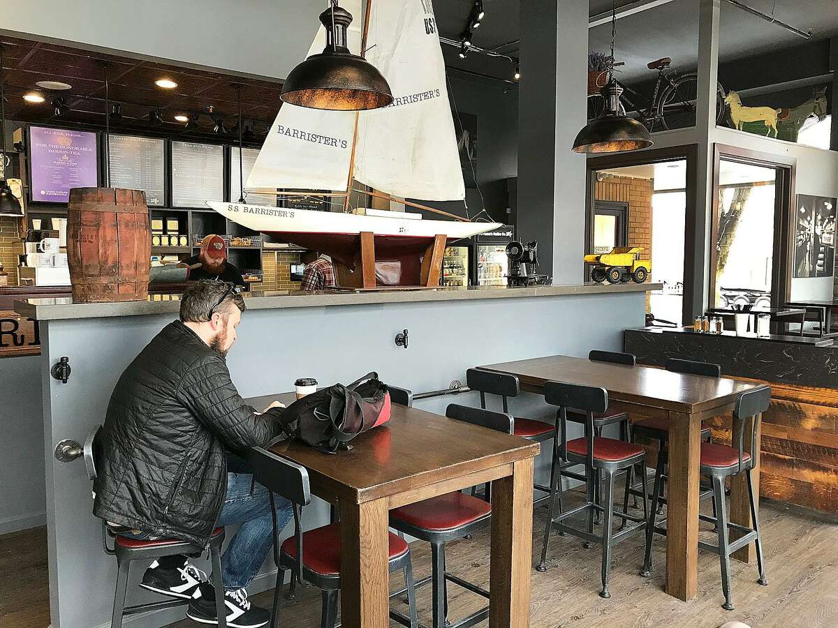 A patron reads a book while drinking coffee at Barrister's Coffee House, a new coffee shop in Danbury, Conn., on Friday, Feb. 2, 2018.