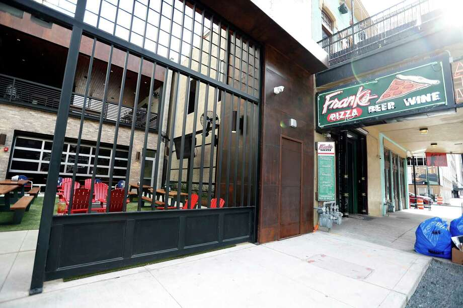 Exterior of Frank's Backyard, next to Frank's Pizza at 413 Travis in downtown Houston.  Frank's Backyard is a new beer garden in a narrow space next to Frank's Pizza. It's owned by owners of Frank's, Eddie and Deborah Love. Photo: Karen Warren, Houston Chronicle / © 2018 Houston Chronicle