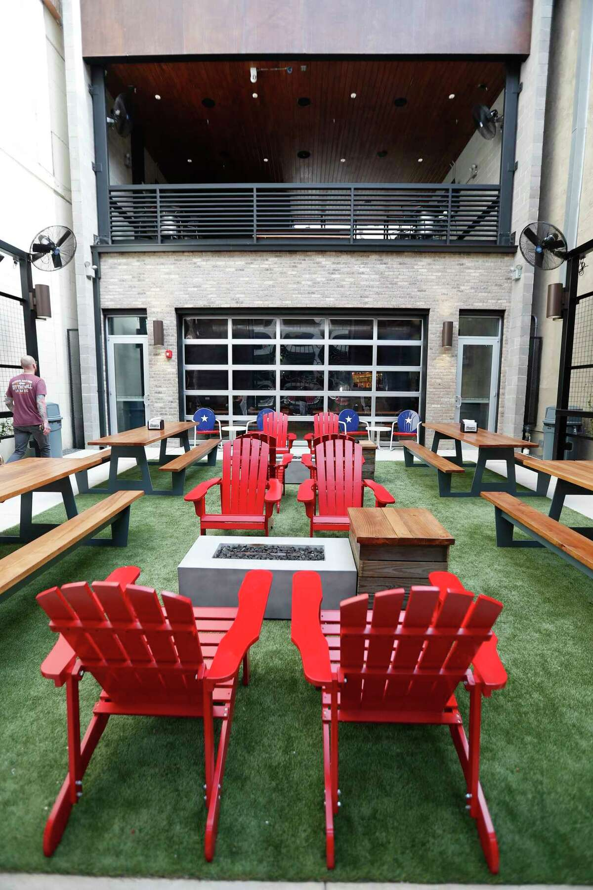 The open air courtyard area with a giant retractable screen at Frank's Backyard, next to Frank's Pizza at 413 Travis in downtown Houston.