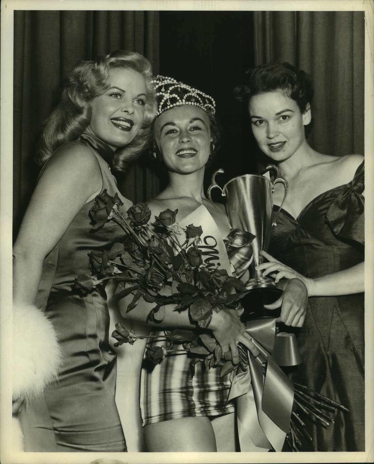 July 7, 1955. Pictured, left to right: Cleo Moore (movie star); Sue Carol Brogier (Miss Houston), Katherine Grandstaff (actress).