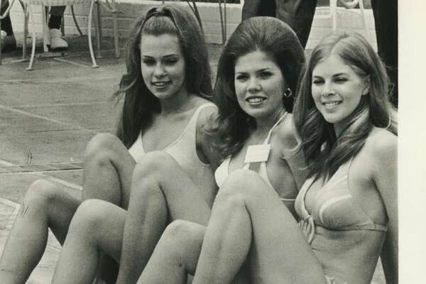 April 12, 1972: Three of the 39 Miss Texas Universe contestants take a breather during pre-pageant activities leading up to Saturday night's finals in San Antonio. From left, Suzan O'Neal, Miss Dallas, Debra Kinler, Miss Ft. Worth and Sherri Vance, Miss Houston.