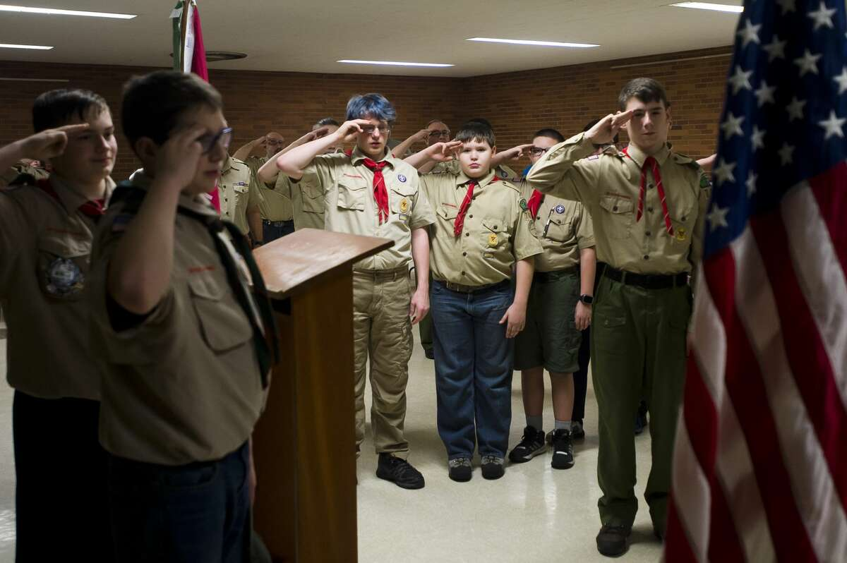 Members of Boy Scout Troop 761 salute the flag during a troop meeting on Friday, Jan. 23, 2018 at First United Methodist Church. (Katy Kildee/kkildee@mdn.net)
