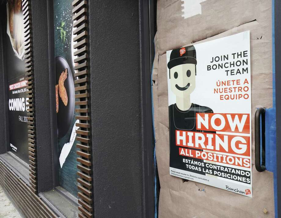 Bonchon Korean fried chicken restaurant advertises that it is hiring prior to the imminent opening of their new branch in the Chelsea neighborhood of New York, seen on Saturday, Dec. 16, 2017. The U.S. economy created 200,00 jobs in January. Photo: Richard B. Levine /TNS / Sipa USA