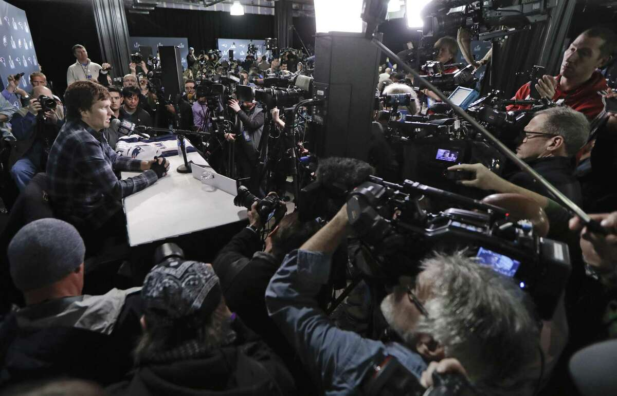 In this Thursday, Feb. 1, 2018, photo, with cameras covering multiple angles, New England Patriots quarterback Tom Brady answers questions during a news conference in Minneapolis. The Patriots are scheduled to face the Philadelphia Eagles in the NFL Super Bowl 52 football game, Sunday, Feb. 4. You can watch the game online for free, and it'll be easier to do so as phone viewing is no longer limited to Verizon customers.