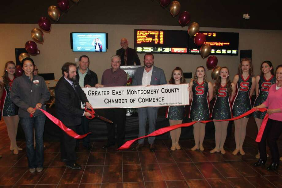 Cinemark General Manager Ronnie Barrington cuts the ribbon welcoming the theater to the Greater East Montgomery County Chamber of Commerce on Jan. 31. Cinemark is the latest business to open up at the Valley Ranch Town Center. Photo: Submitted