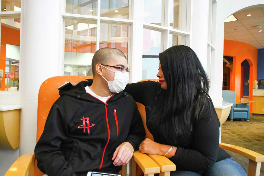 Jacob Munoz, a 16-year-old sophomore student from Spring at Klein Cain High School, is going through his second diagnoses of leukemia and visits with his mom Yvette Munoz while waiting for treatment at Texas Childrens Hospital. Photo: Tony Gaines/ HCN, Staff / Houston Chronicle