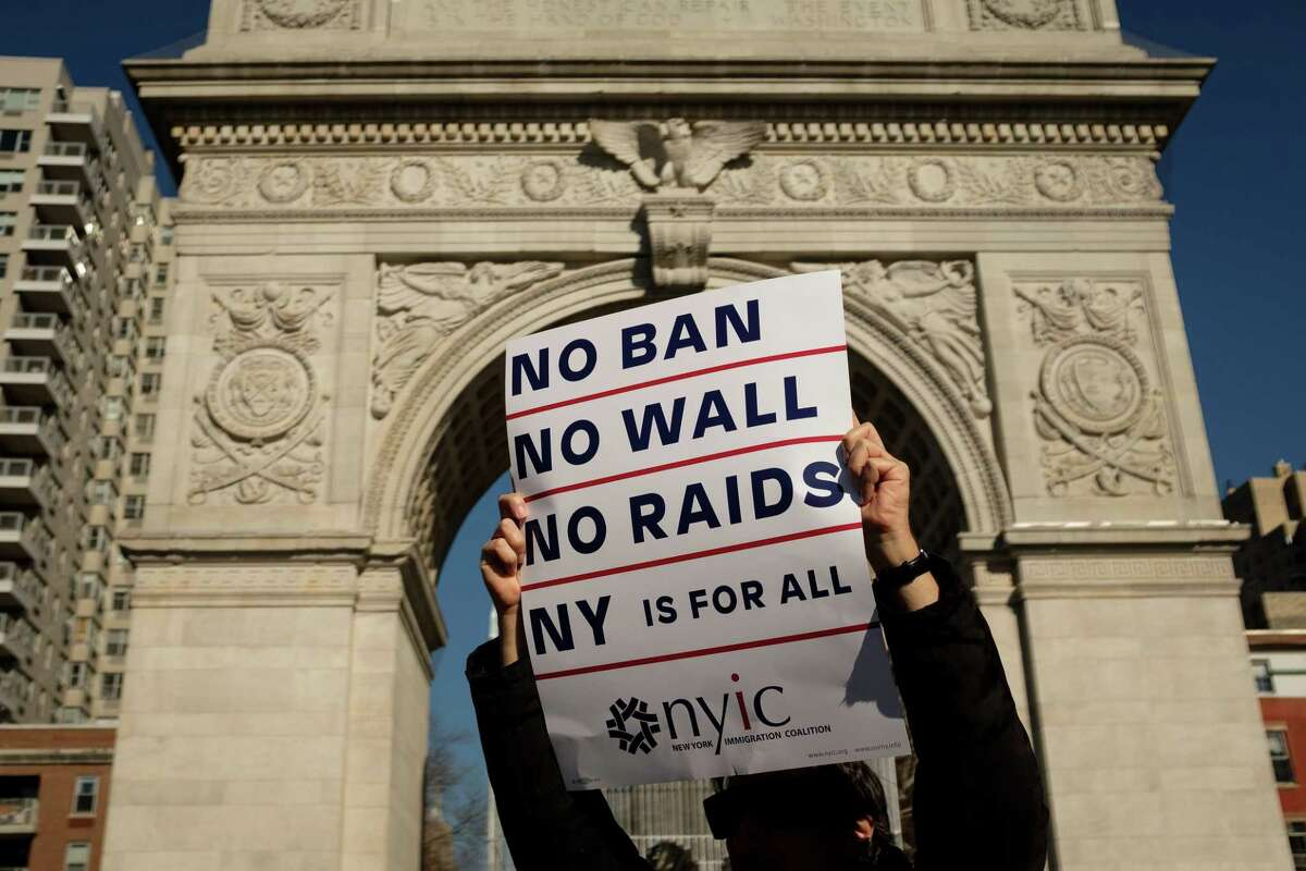 Activists rally to mark the one-year anniversary of the Trump administration's executive order banning travel into the United States from several Muslim majority countries. The fears that spawn such bans are as old as this nation.
