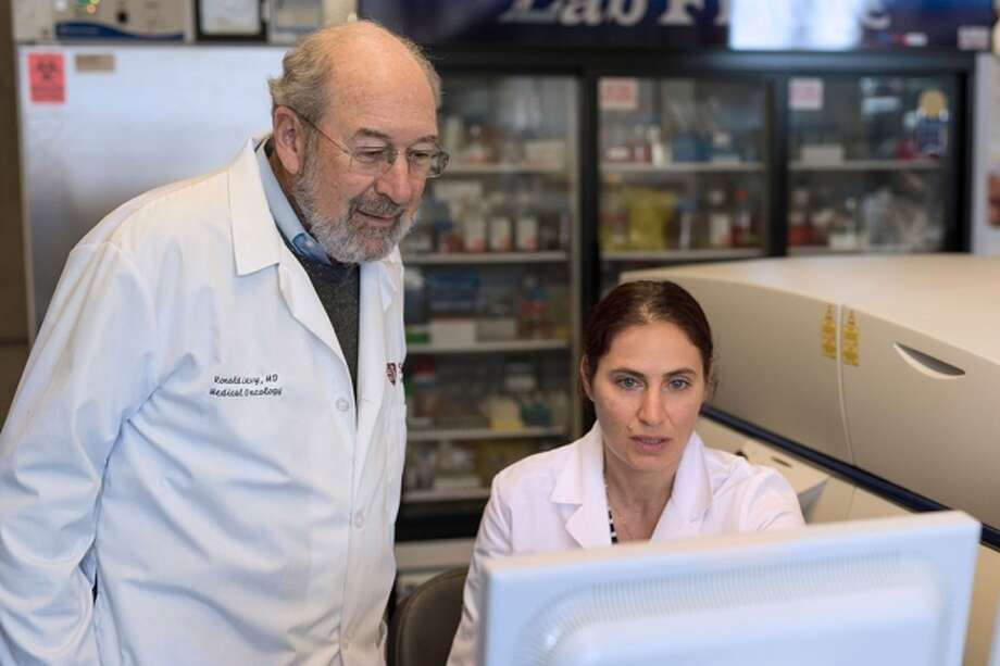 Ronald Levy (left) and Idit Sagiv-Barfi led the work on a possible cancer treatment that involves injecting two immune-stimulating agents directly into solid tumors. Photo: Stanford Medicine News Center