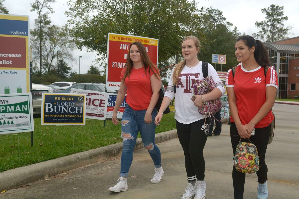 Vanessa Munoz, 18 (from left), Lauren Gernant, 18, and Simran Kakkar, 18, all Texas A&M students and residents of The Woodlands, vote on Nov. 8. School districts in Texas are charged with fostering such
