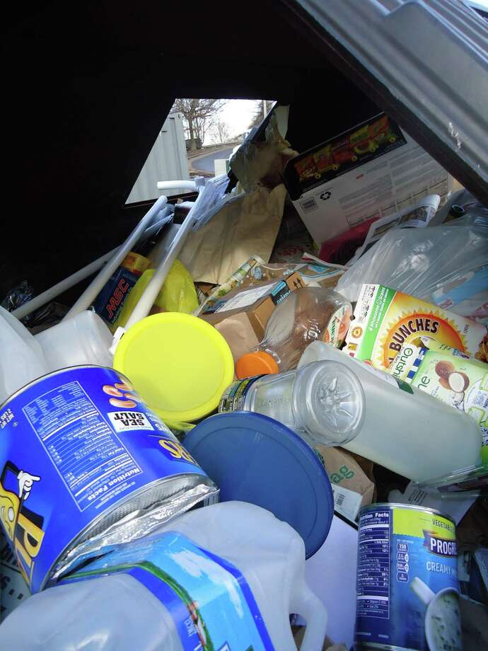 The recycling container in the Stratford Transfer Station on Watson Boulevard. Many of the items here can't be recycled, such as the plastic bags and the PVC pipe. Photo: John Burgeson / Hearst Connecticut Media