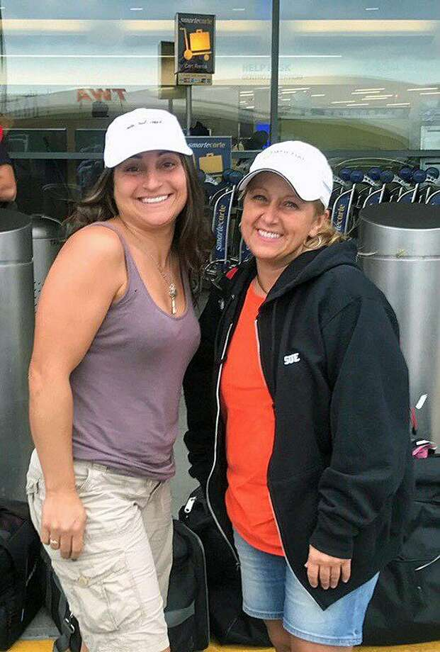 Left to right: Melissa Marter, who lives in Stratford, Conn., and owns Whos Your Doggie in Milford, and Sue Maraczi, of Milford, Conn., who works as a licensed emergency and critical care nurse at the Animal Medical Center in New York City, at the airport Thursday, Sept. 28, 2017, before taking off to help animals in need in the Caribbean after Hurricane Irma. Photo: Contributed Photo / Sue Maraczi / Contributed Photo / Connecticut Post Contributed