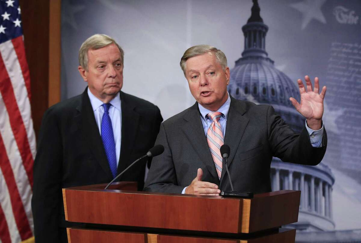 Sen. Lindsey Graham, R-South Carolina, right, with Sen. Dick Durbin, D-Illinois, speak during a news conference on Capitol Hill in September to discuss their bipartisan Dream Act. Critics decry this bill as amnesty.