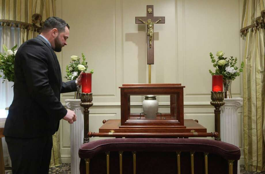 Anthony Notaro, Funeral Director and Crematory Manager at Nicholas F. Cognetta Funeral Home and Crematory, lights candle near the ark housing the urn for a funeral service Thursday, February 1, 2018, 104 Myrtle Ave., in Stamford, Conn. Over 50 percent of the deceased in Connecticut are now cremated, leading to more funeral homes offering the service. Photo: Erik Trautmann / Hearst Connecticut Media / Norwalk Hour