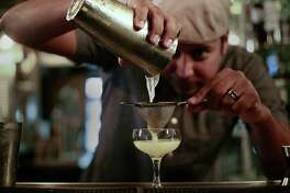Jeret Peña pours a Silk Road cocktail in a coupe glass at now-closed The Brooklynite.