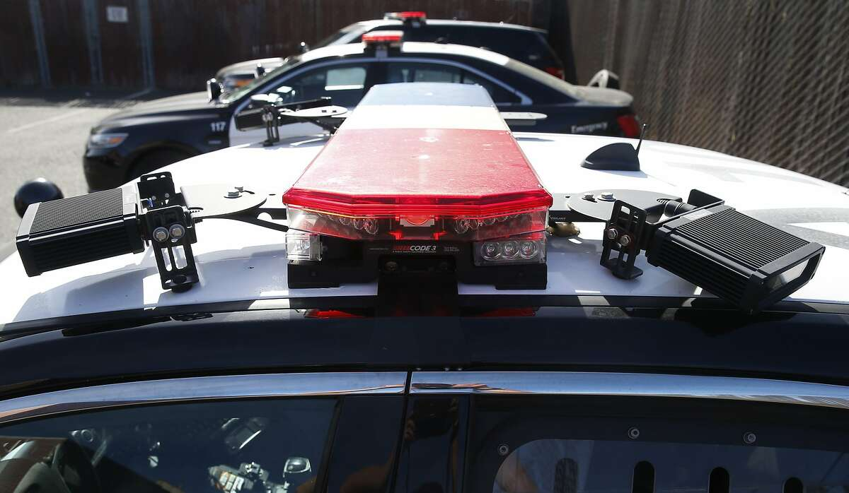Mobile license plate readers are mounted on either side of the light bar on the roof of a police cruiser in Alameda, Calif. on Friday, Feb. 2, 2018. The Alameda City Council will vote on a plan to install license plate readers mounted on posts at all entry points into the island city.