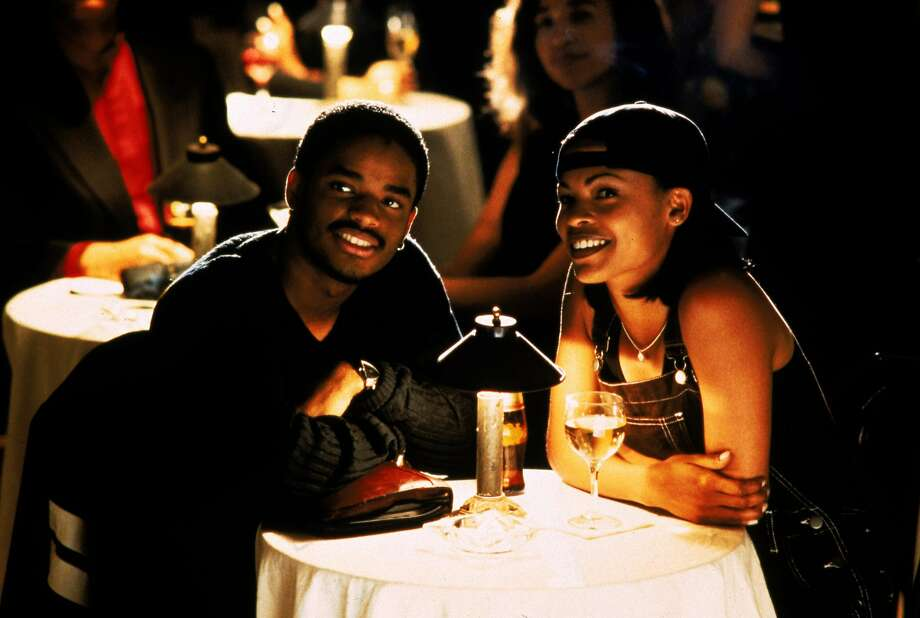 "Poet Darius Lovehall (Larenz Tate, left) and photographer Nina Moseley (Nia Long) look for love in ""Love Jones."" Photo: New Line Cinema"