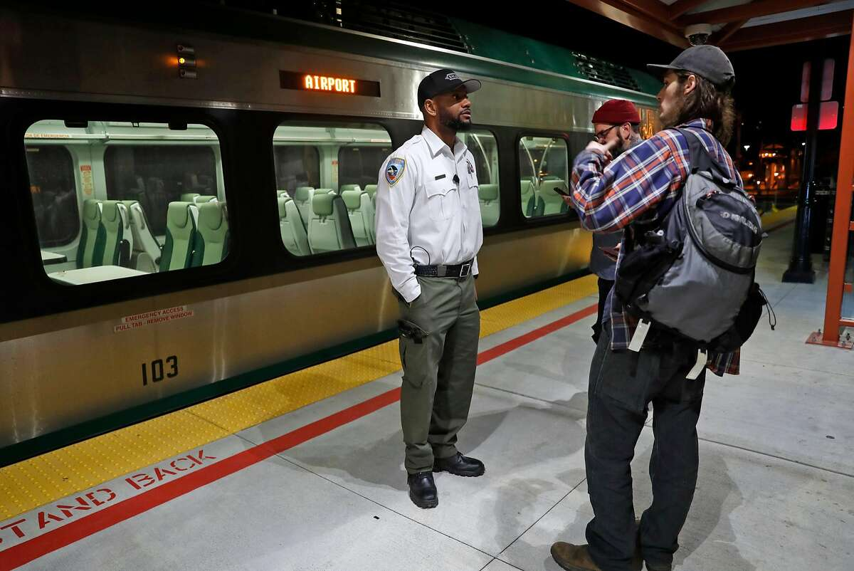 SMART conductor Antonio Horton answers questions for train riders in San Rafael, Calif., on Wednesday, January 31, 2018.