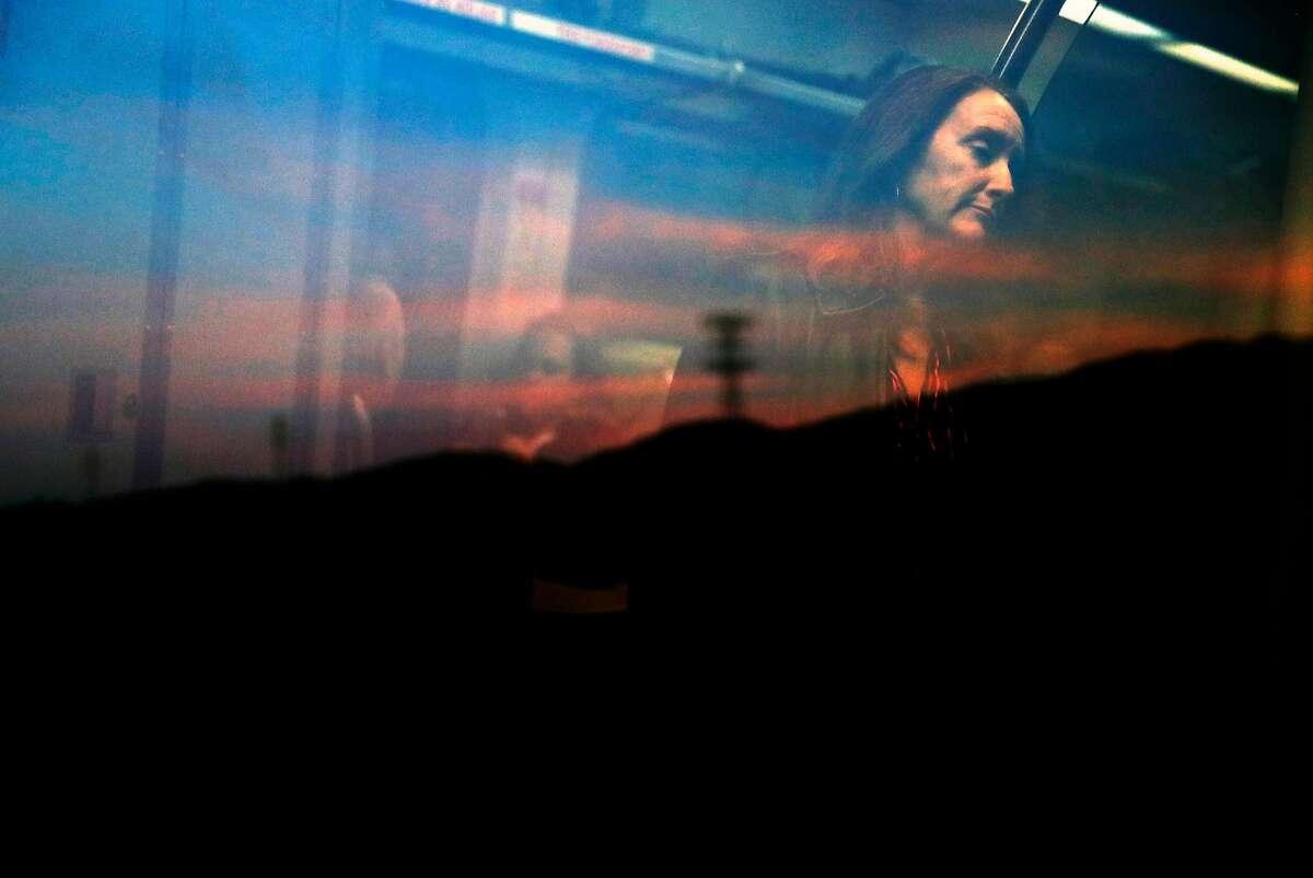 SMART train commuter Sheila Mone heads north through Novato, Calif., on Wednesday, January 31, 2018.