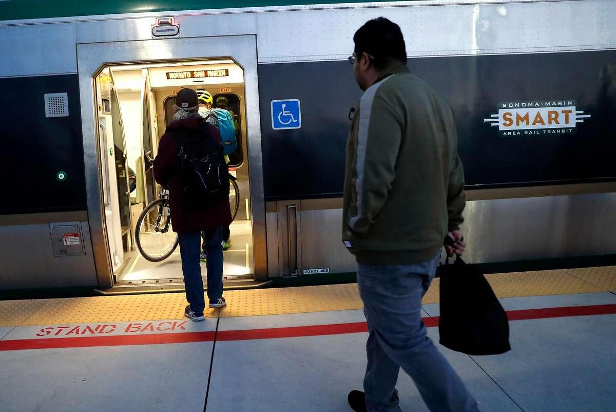 SMART train riders board a train at Novato San Marin station in Novato, Calif., on Wednesday, January 31, 2018.