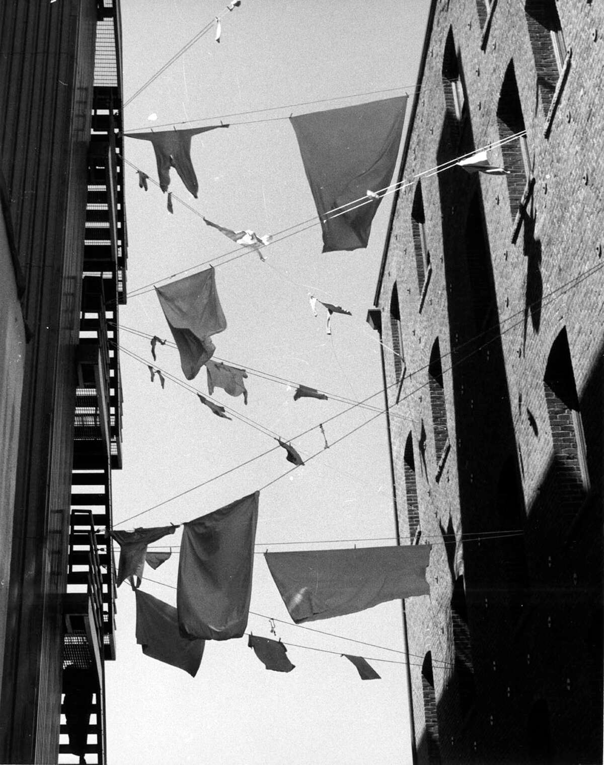 Seattle's Post Alley on May Day 1978. Laundry hangs across alley.