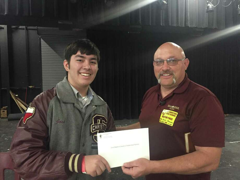 Joshua Pink, left, a senior at San Antonio Christian School, suggested donating proceeds from his class's annual barbecue to First Baptist Church of Sutherland Springs. The pastor, Frank Pomeroy, accepted the gift Friday and spoke to the students. Photo: /Courtesy