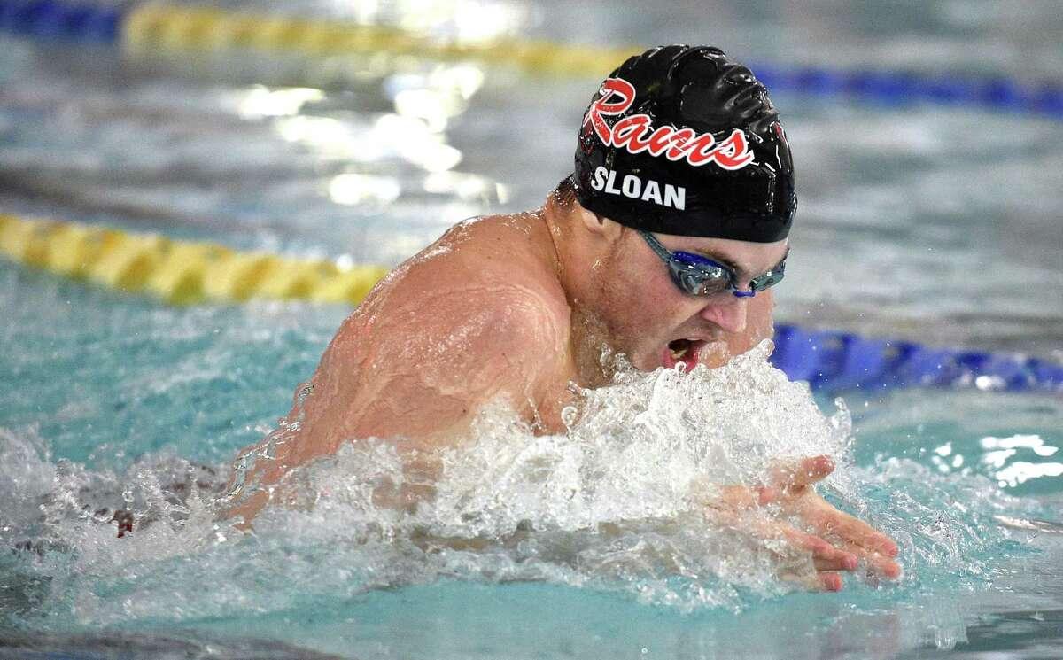New Canaan Peter Sloan competes in the Boys 100 Meter Breast Stroke during a FCIAC Boys Swimming Dual Meet against Darien at the Darien YMCA in Darien, Conn., Friday, Feb. 2, 2018.