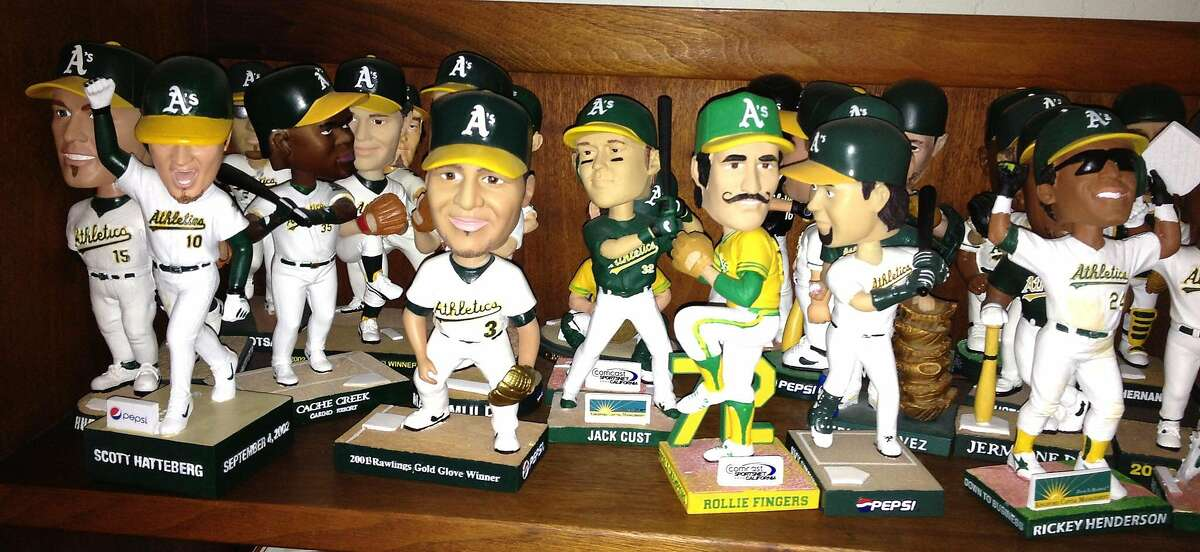 An assortment of Oakland A's bobble heads from the 1990s and 2000s.