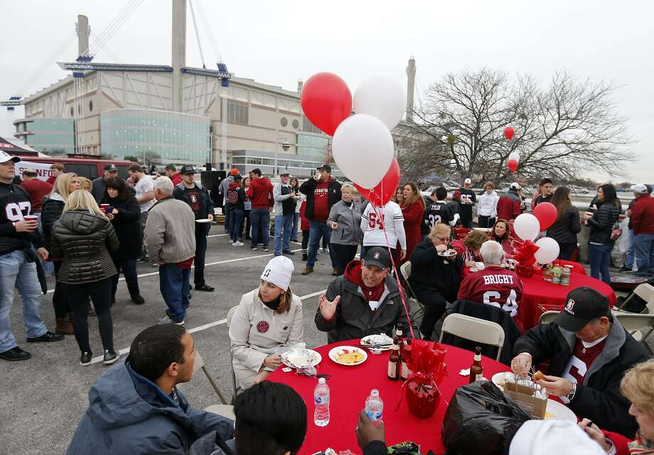 Stanford University fans Carey and Jeff Riccitelli (center left), parents of Stanford place kicker Collin Riccitelli (37) and others tailgate before the Alamo Bowl held Dec. 28, 2017, at the Alamodome. Photo: Edward A. Ornelas /San Antonio Express-News / © 2017 San Antonio Express-News