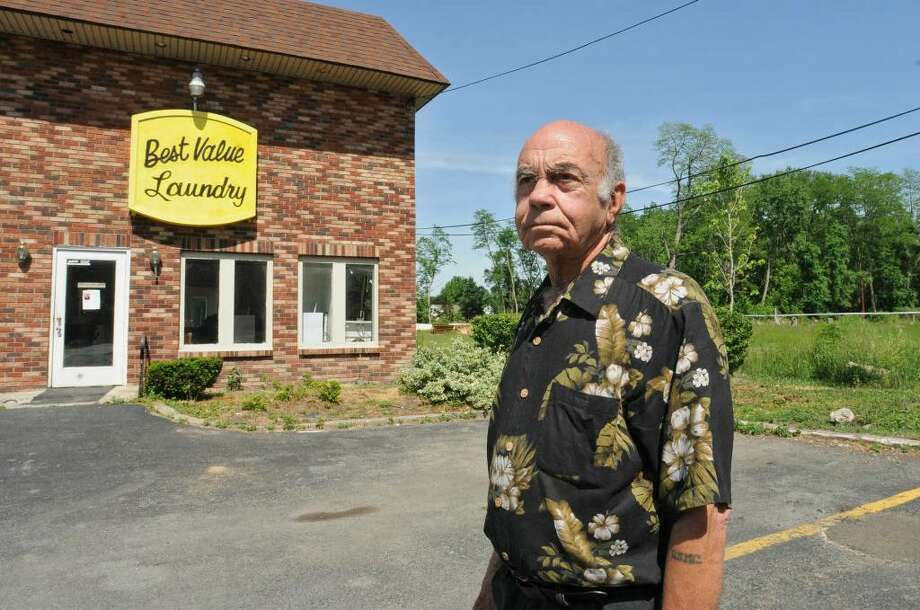 Carlos Barrera, 84, stands in front of his Best Value Motel in Colonie, NY on June 2, 2010.  Barrera wants to build a new motel next to the existing motel. He's invested close to $300,000, and now the town is looking at a moratorium on motels. (Lori Van Buren / Times Union) Photo: LORI VAN BUREN