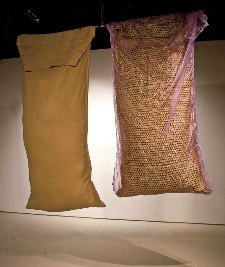 "George Wohnsen ""Sachet,"" 2009, burlap, cedar sachet; cheese cloth, suntan oil sachet; taffeta, and batting, 7 x 4 x 1 ? feet each"
