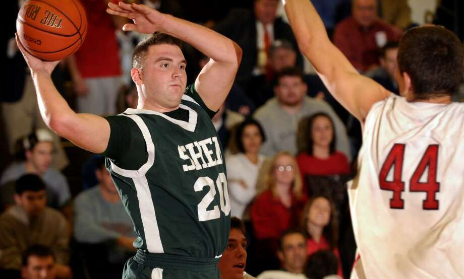 Shenendehowa's Josh Koopman,left, is defended by Albany Academy's David Benocs. (Hans Pennink/Special to the Times Union) Photo: Hans Pennink