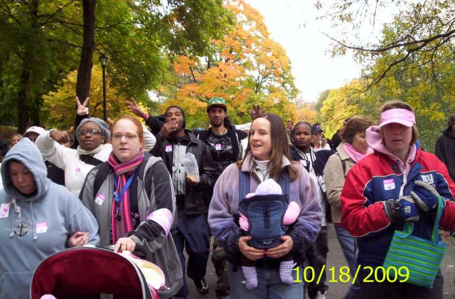 Students from the Glenmont Job Corps Center take part in the Making Strides Against Breast Cancer Walk in Washington Park. They also held a bake sale to benefit the American Cancer Society.