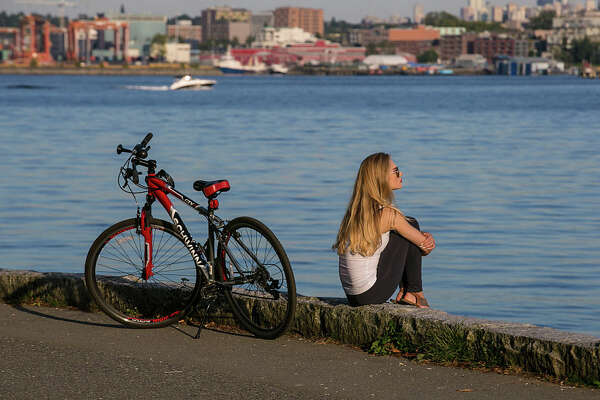 """The Stanley Park Seawall is part of the world's longest uninterrupted waterfront path. It is divided between paths for walkers and joggers (close to the water) and bicyclists and those on roller skates. The full route is described by former-B.C. Cabinet minister Tom Perry: """"I take the bike route around seawall, including the new Point Grey road widening as bicycle route . . . So that one can ride from Spanish Banks to Alma Street (start of road), then largely take the bike path around Vanier Park, and all around False Creek, and hence to Stanley Park."""""""
